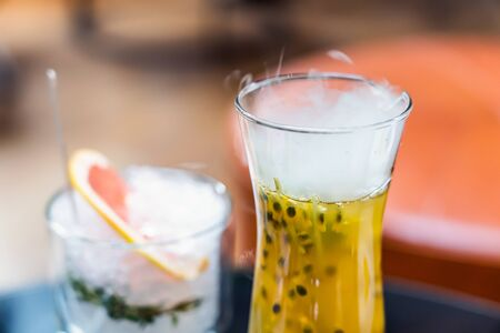Steam is Coming Out from Passion Fruit Juice. Refreshing Summer Drink.