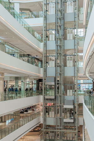 SHANGHAI, CHINA - NOVEMBER 10, 2018. Panoramic Lifts in the Atrium of a New Shopping Mall LuOne Shanghai. Glass Elevators in White Retail Interior Design. 에디토리얼