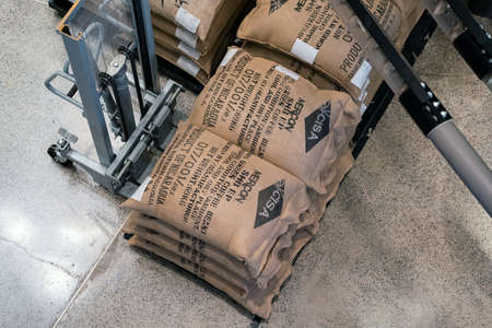 SHANGHAI, CHINA - NOVEMBER 10, 2018. Bags of Coffee Bean on the Floor to be Lifted by Fork Lift. Batch of CISA and Merkon Branded Linen Sacks.