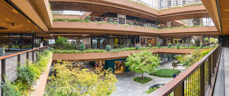 SHANGHAI, CHINA - NOVEMBER 10, 2018. Ruihong Tiandi Shopping Mall. External Courtyard of Retail Complex Lush Greenery. Panorama of Garden with Footbridge and Terraces. Green Sustainable Architecture.