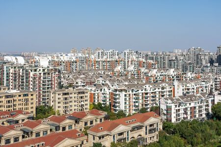 Skyline of Regular Chinese City on a Sunny Day. Common Buildings in Residential District. Modern Generic Architecture in Shanghai.