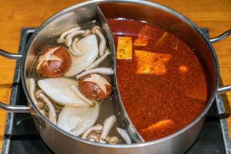 Specially made pot for soup base combo option to have two flavors spicy and mushroom of hot bouillon.