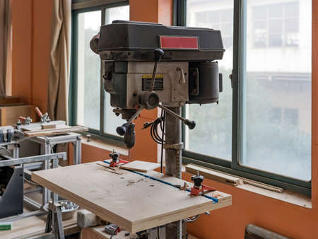 SHANGHAI, CHINA - NOVEMBER 24, 2018. Carpenter's Equipment and Work Bench in Joiner's Wood Shop. Machine for Drilling Woodwork Holes Workshop.