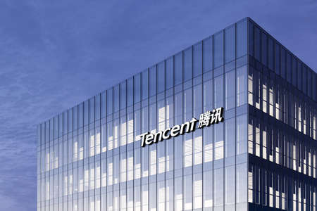Shenzhen, China. February 17, 2021. Editorial Use Only, 3D CGI. Tencent Holding Corporation Signage Logo on Top of Glass Building. Workplace Internet Company Office Headquarter. Редакционное