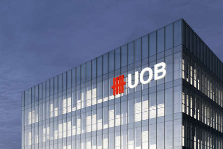 Singapore. February 27, 2021. Editorial Use Only, 3D CGI. UOB Signage Logo on Top of Glass Building. United Overseas Bank Corporation Company in High-rise Office Headquarter.