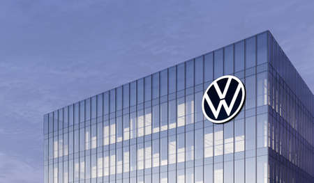 Wolfsburg, Germany. February 27, 2021. Editorial Use Only, 3D CGI. Volkswagen Automaker Corporation Motors Signage Logo on Top of Glass Building. Workplace VW Car Company Office Headquarter.