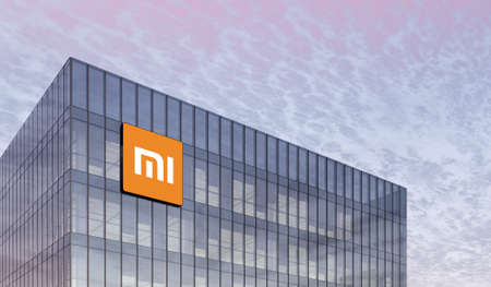 Beijing, China. February 27, 2021. Editorial Use Only, 3D CGI. Xiaomi Holding Corporation Signage Logo on Top of Glass Building. Home Electronics Company Company Mi Office Headquarter. Редакционное