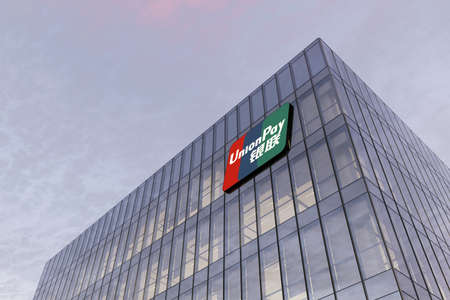 Pudong, Shanghai, China. February 17, 2021. Editorial Use Only, 3D CGI. UnionPay Signage Logo on Top of Glass Building. Workplace Bank Card Services Office Headquarter.