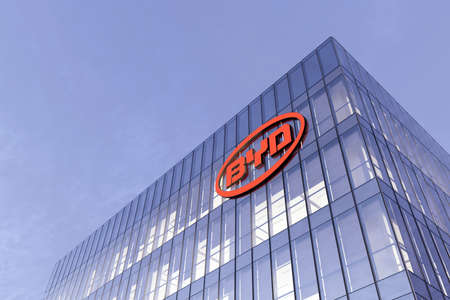 Shenzhen, China. February 18, 2021. Editorial Use Only, 3D CGI. BYD Auto Signage Logo on Top of Glass Building. Workplace Car Company Office Headquarter.