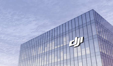 Shenzhen, China. February 25, 2021. Editorial Use Only, 3D CGI. SZ DJI Technology Co. Signage Logo on Top of Glass Building. Workplace of Robot Sciences Company in High-rise Office Headquarter.