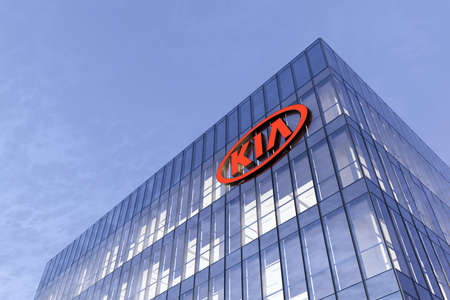 Seoul, South Korea. February 17, 2021. Editorial Use Only, 3D CGI. Kia Corporation Motors Signage Logo on Top of Glass Building. Workplace Car Company Office Headquarter.