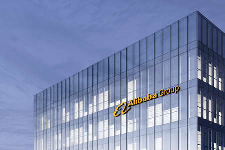 Hangzhou, China. February 17, 2021. Editorial Use Only, 3D CGI. Alibaba Group Signage Logo on Top of Glass Building. Workplace Internet E-commerce Company Office Headquarter.