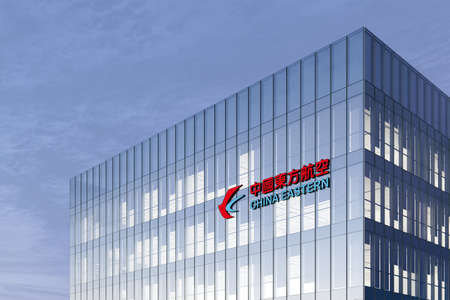 Shanghai, China. February 19, 2021. Editorial Use Only, 3D CGI. China Eastern Airlines Corporation Signage Logo on Top of Glass Building. Workplace Airline Company Office Headquarter.