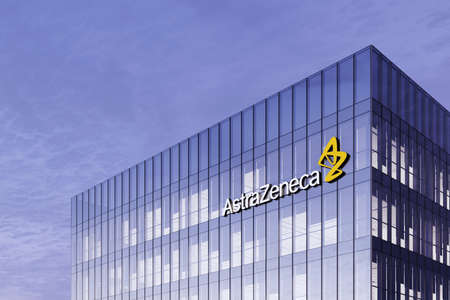 Cambridge, United Kingdom. February 16, 2021. Editorial Use Only, 3D CGI. Pharmaceutical Company Astrazeneca Signage Logo on Top of Glass Building. Workplace in High-rise Office Headquarter.