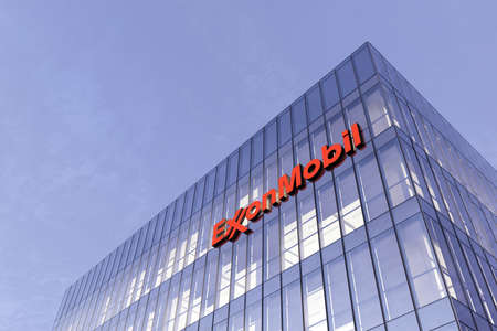 Irving, Texas, United States. February 25, 2021. Editorial Use Only, 3D CGI. ExxonMobil Signage Logo on Top of Glass Building. Workplace of Gas and Oil Company in High-rise Office Headquarter. Éditoriale