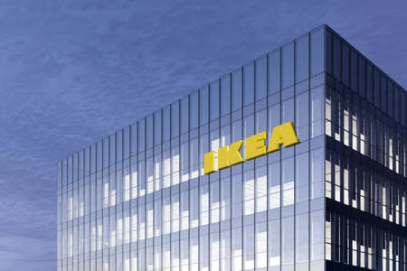 Delft, Netherlands. February 25, 2021. Editorial Use Only, 3D CGI. Ikea Signage Logo on Top of Glass Building. Workplace of Furniture Company in High-rise Office Headquarter.