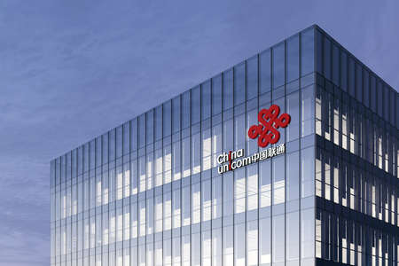 Hong Kong, China. February 19, 2021. Editorial Use Only, 3D CGI. China Unicom Corporation Signage Logo on Top of Glass Building. Workplace Telecommunication Company Office Headquarter. Редакционное