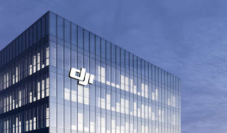 Shenzhen, China. February 25, 2021. Editorial Use Only, 3D CGI. SZ DJI Robitics Technology Co. Signage Logo on Top of Glass Building. Workplace of Robot Sciences Company in High-rise Office Headquarter.