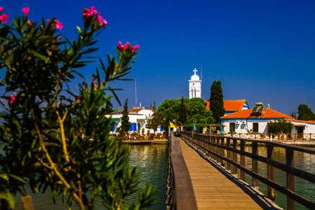 monastery nature: Beautiful church on the island bay in Greece Stock Photo