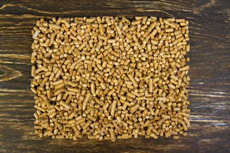 emit: I invite you to see my other illustration with pellets! Pellets - the new eco-friendly fuel, made from pine wood shavings. Pellets are more environmentally friendly than coal. Pellets emit only half as much heat Nathon than natural gas per cubic meter. Stock Photo