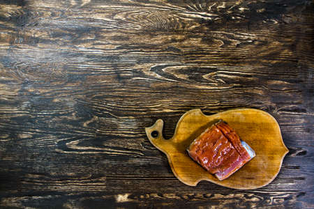 aliments: Tasty salmon fillet looks good on the old wood.  Image have free space for needed design for you.