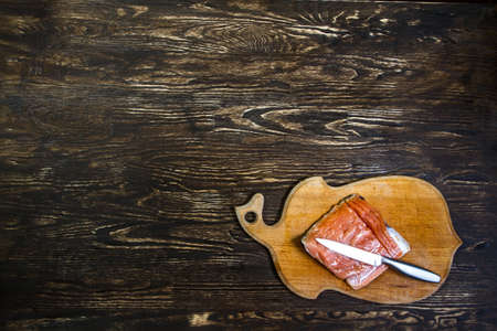 foodstuff: Tasty salmon fillet looks good on the old wood.  Image have free space for needed design for you.