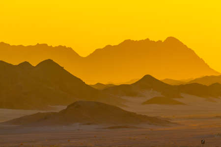 sinai desert: Dawn. The sun rises from behind the mountains in the Sinai desert Stock Photo