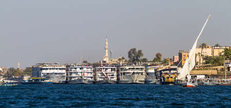 Nile river. Ships, yachts, fishing boats against the backdrop of ancient temples Editorial