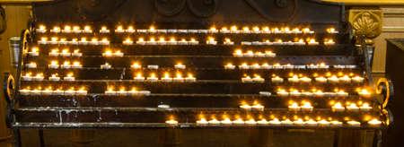 Candles burn in a Christian church in Mukacheve, Ukraine Archivio Fotografico