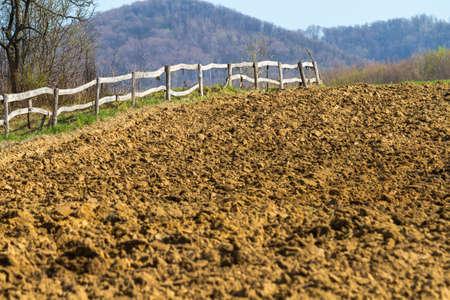 Freshly plowed field on a farm in the mountains, Mukachevo, Ukraine