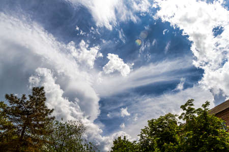 In the sky, with stunning clouds of clouds and a piercing blue sky. Waiting for the storm. Storm is coming