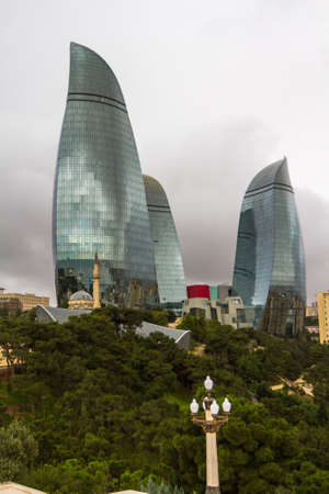 Landscapes of autumn Baku, Azerbaijan. Old and new - a modern skyscraper and an ancient mosque. Editorial