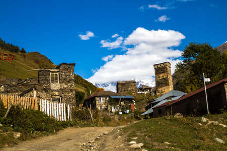 Houses, landscapes and Svan towers of Ushguli. Ushguli is the most highland permanently inhabited community in Europe. It is located at an altitude of 2,200 meters. Stock Photo