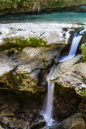 kutaisi: Martvil Canyon, Georgia, Kutaisi. Blue river, lakes with transparent water, waterfalls, canyon walls, overgrown with moss.