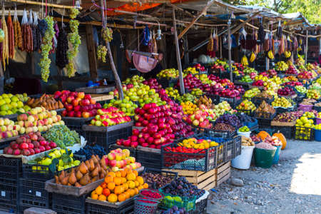 roadside stand: Roadside fruit and vegetable market in Georgia. Grapes, apples, pears, pomegranates, nuts, churchella, plums, dates, pepper, raspberries, strawberries, Stock Photo