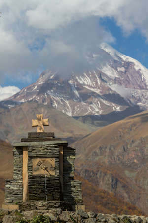 The Trinity Church in Gergeti is located at an altitude of 2,170 m at the foot of Kazbek along the Georgian Military Road in the Georgian village of Gergeti on the right bank of the river Cheheri, directly above the village of Stepantsminda.