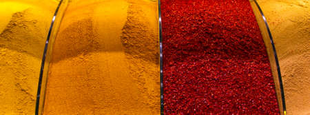 Multicolored oriental spices, teas, dried fruits and nuts on the counter in the eastern market Archivio Fotografico