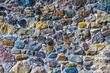 Background, texture, multi-colored stones of different shapes in solution