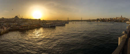 Istanbul, Golden Horn Bay, Sunset. Panorama, both banks of the bay and famous mosques are visible.