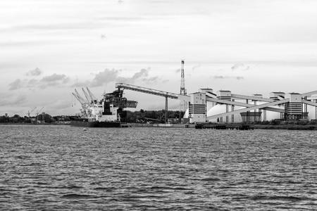 Mineral transshipment at port. Stock Photo