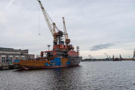 Ship and port cranes at repair area. Stock Photo