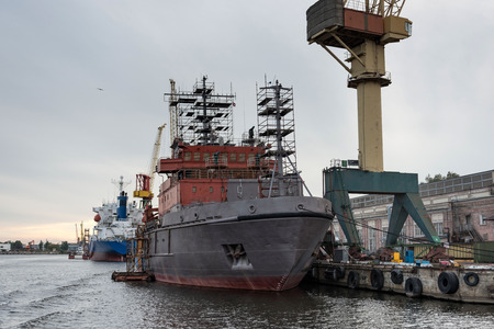 Ship and port cranes at repair area. Stock Photo
