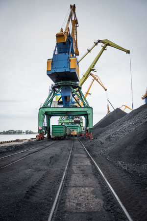 Work in port coal handling terminal. Фото со стока