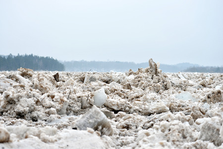 Spring flood threat. The ice jam on the river.