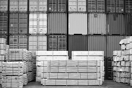 neatly stacked: Containers and neatly stacked timber stock.