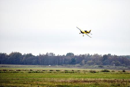 piloting: AIZPUTE, LATVIA - OCTOBER 15, 2016: Meadow lands airplane model. Editorial