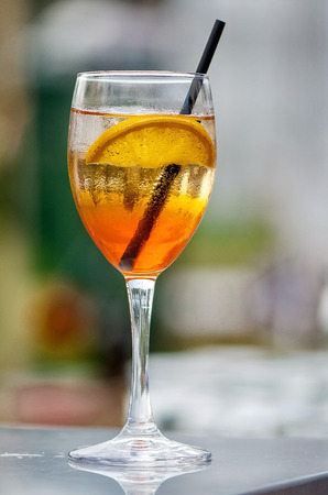 Cocktail with orange slice and a straw. Stock Photo