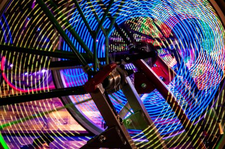 spokes: Abstract play of light with lights in bicycle wheel spokes.