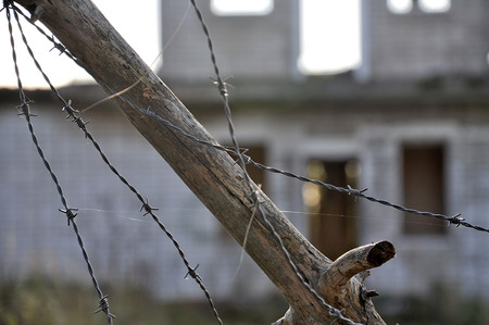 A protection zone of barbed wire at the old buildings.