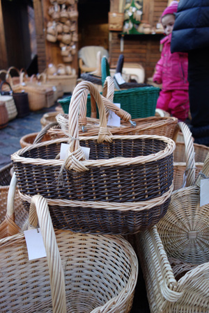 In the christmas  market a wide selection of a variety of hand-braided baskets.